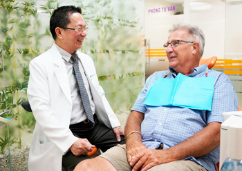 Dr. Hung with patient
